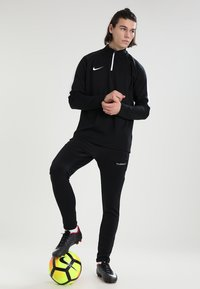 Hummel - TECH MOVE  - Tracksuit bottoms - black - 1