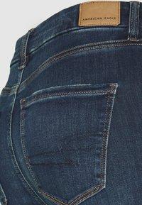 American Eagle - CURVY SUPER HIRISE JEGGING - Jeans slim fit - midnight blue - 2
