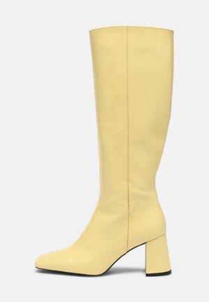 Boots - butter yellow