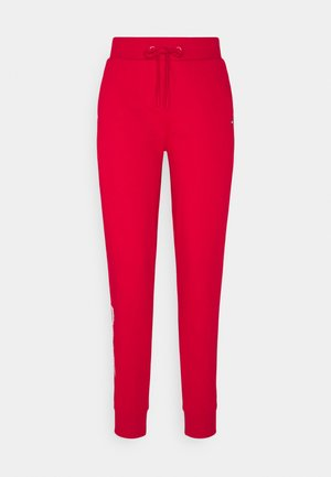 REGULAR GRAPHIC PANT - Tracksuit bottoms - red