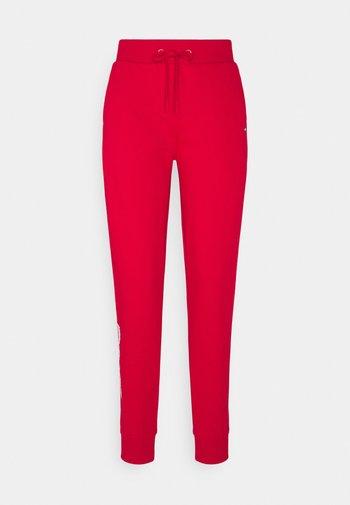 REGULAR GRAPHIC PANT - Pantalon de survêtement - red