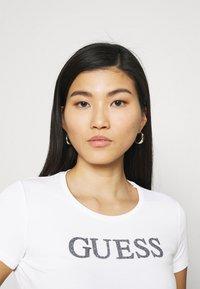 Guess - MIRIANA TEE - Print T-shirt - true white - 3
