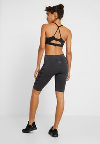 Hummel - SEAMLESS CYCLING - Sports shorts - black melange - 2
