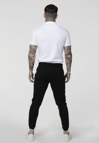SIKSILK - STRETCH FIT ZIP COLLAR - Polo shirt - white - 2