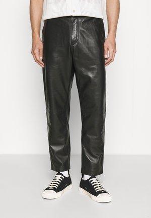 KEANU - Leather trousers - black