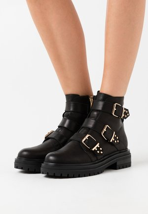 FRANKA STRAPPY - Cowboy/biker ankle boot - black