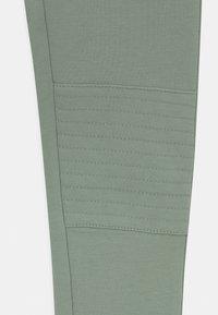 Lindex - MINI BIKER TURBO - Leggings - Trousers - light dusty green - 2