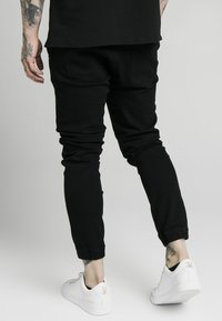 SIKSILK - CUFFED - Jeans Skinny Fit - black