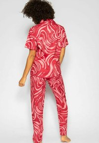 Cyberjammies - KRISTEN  - Pyjama bottoms - red spiral - 3