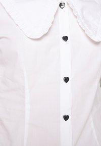Monki - SANDRA BLOUSE - Button-down blouse - white - 6