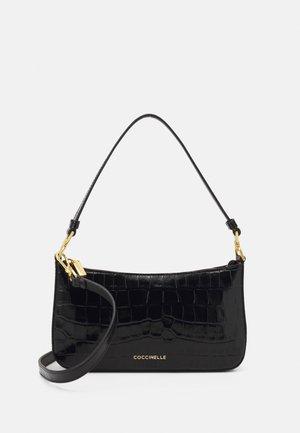 BONHEUR CROCO SHINY SOFT MINI CROSSBODY BAG - Across body bag - noir