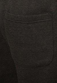 Urban Classics - SWEATPANTS SP. - Tracksuit bottoms - charcoal - 4
