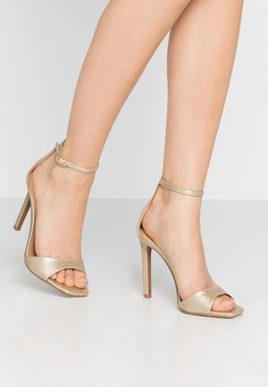 SILVY SKINNY PART - High heeled sandals - gold