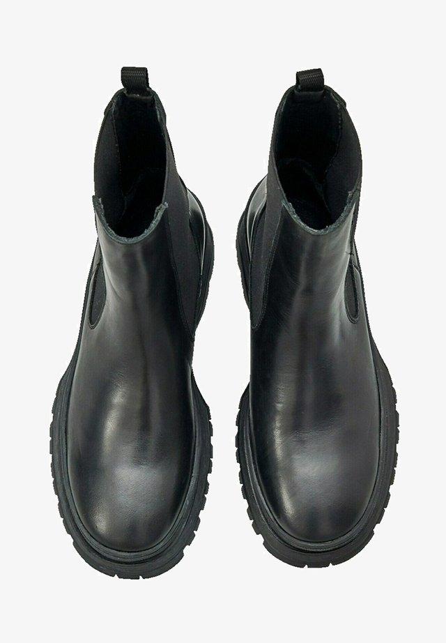 MAIGA - Korte laarzen - schwarz