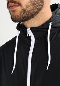 Urban Classics - Light jacket - black/white - 3