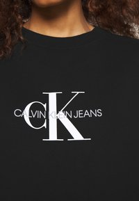 Calvin Klein Jeans - MONOGRAM CREWNECK DRESS - Sukienka letnia - black - 6