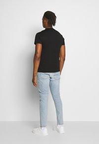 Versace Jeans Couture - T-shirts print - black - 2
