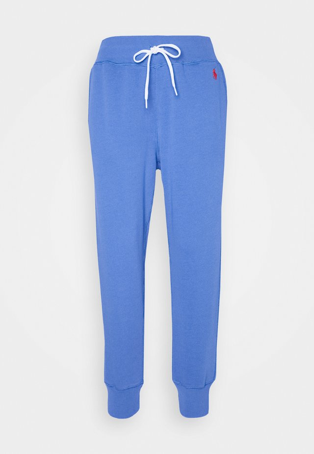 SEASONAL - Tracksuit bottoms - resort blue