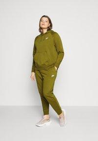 Nike Sportswear - PANT - Tracksuit bottoms - olive - 1