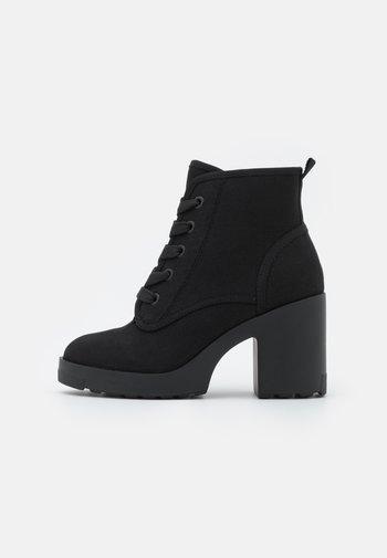 MOLLYY - Šněrovací kotníkové boty - black