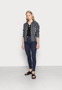 Gina Tricot - HIGHWAIST - Jeans Skinny Fit - rinsed denim - 1