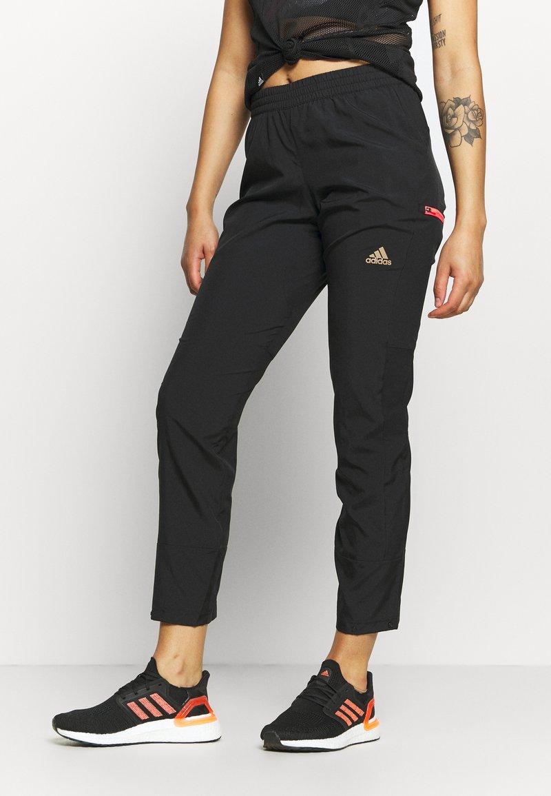 adidas Performance - ADAPT  - Tracksuit bottoms - black