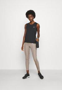 Nike Performance - RUN TANK - Topper - black/bright crimson - 1
