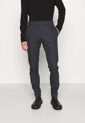 ZIRIND TROUSERS - Spodnie materiałowe - black