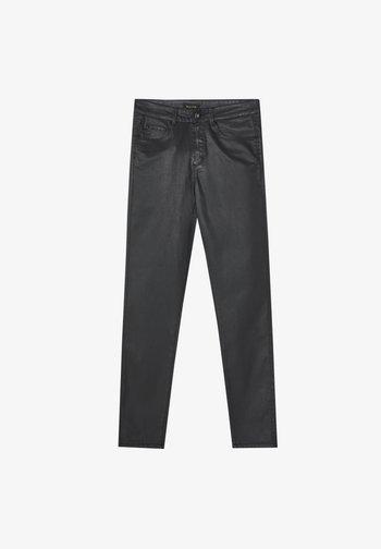 MIT GUMMIERTEM FINISH - Jeans Skinny Fit - black