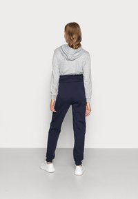 Anna Field MAMA - Tracksuit bottoms - dark blue - 2