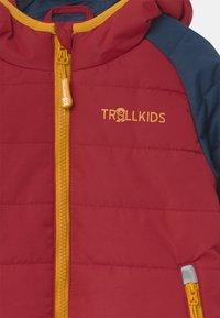 TrollKids - HAFJELL SNOW PRO UNISEX - Ski jacket - mystic blue/rusty red/golden yellow - 3