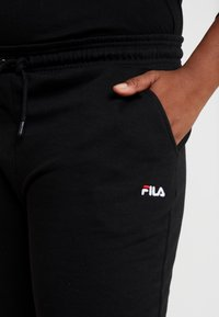 Fila Plus - EIDER PANTS - Verryttelyhousut - black - 4
