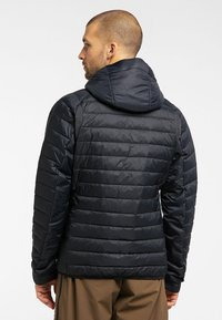 Haglöfs - SPIRE MIMIC HOOD  - Winter jacket - true black - 1