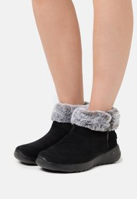 Skechers - ON THE GO JOY - Ankle boots - black/gray - 0