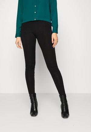 THEA - Leggings - Trousers - black