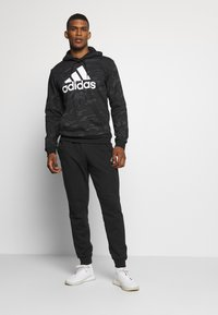 adidas Performance - ESSENTIALS TRAINING SPORTS PANTS - Jogginghose - black/white - 1