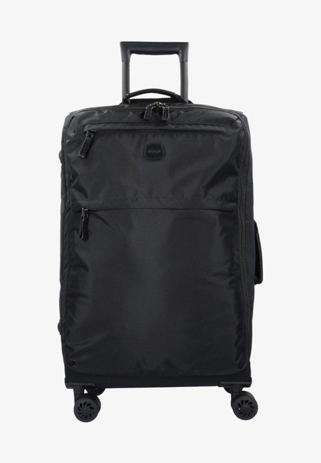 X TRAVEL  - Wheeled suitcase - black