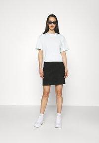 Nike Sportswear - T-shirts - barely green/white - 1