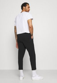 Redefined Rebel - JOHNNY PANTS - Trousers - black - 2