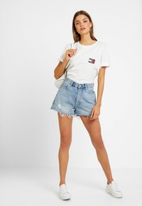 Tommy Jeans - HOT PANT SHORT ADRMR - Denim shorts - light blue denim - 1