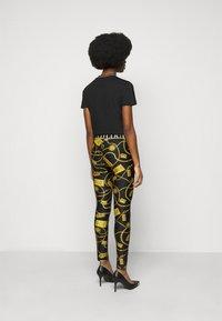 Versace Jeans Couture - Leggings - Trousers - black - 2