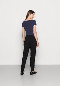 MAMALICIOUS - MLCERISE PANT - Spodnie materiałowe - black - 2