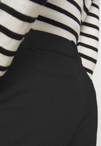 Claudie Pierlot - PATEL - Trousers - noir - 5