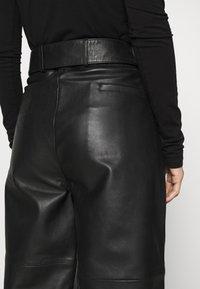 Deadwood - POPPY PANTS - Leather trousers - black - 3