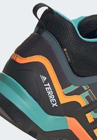 adidas Performance - TERREX SWIFT R2 MID GORE-TEX HIKING SHOES - Hiking shoes - green - 9