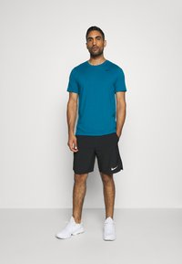 Nike Performance - DRY TEE CREW SOLID - Basic T-shirt - green abyss/black - 1