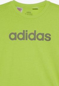 adidas Performance - LIN UNISEX - T-shirt imprimé - neon green/olive - 3