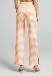 Bershka - Trousers - orange - 2