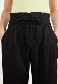 Bershka - PAPERBAG - Trousers - black - 3