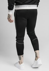 SIKSILK - DELUXE AGILITY JOGGER - Tracksuit bottoms - black - 4